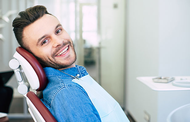 Young man sitting in dental chair